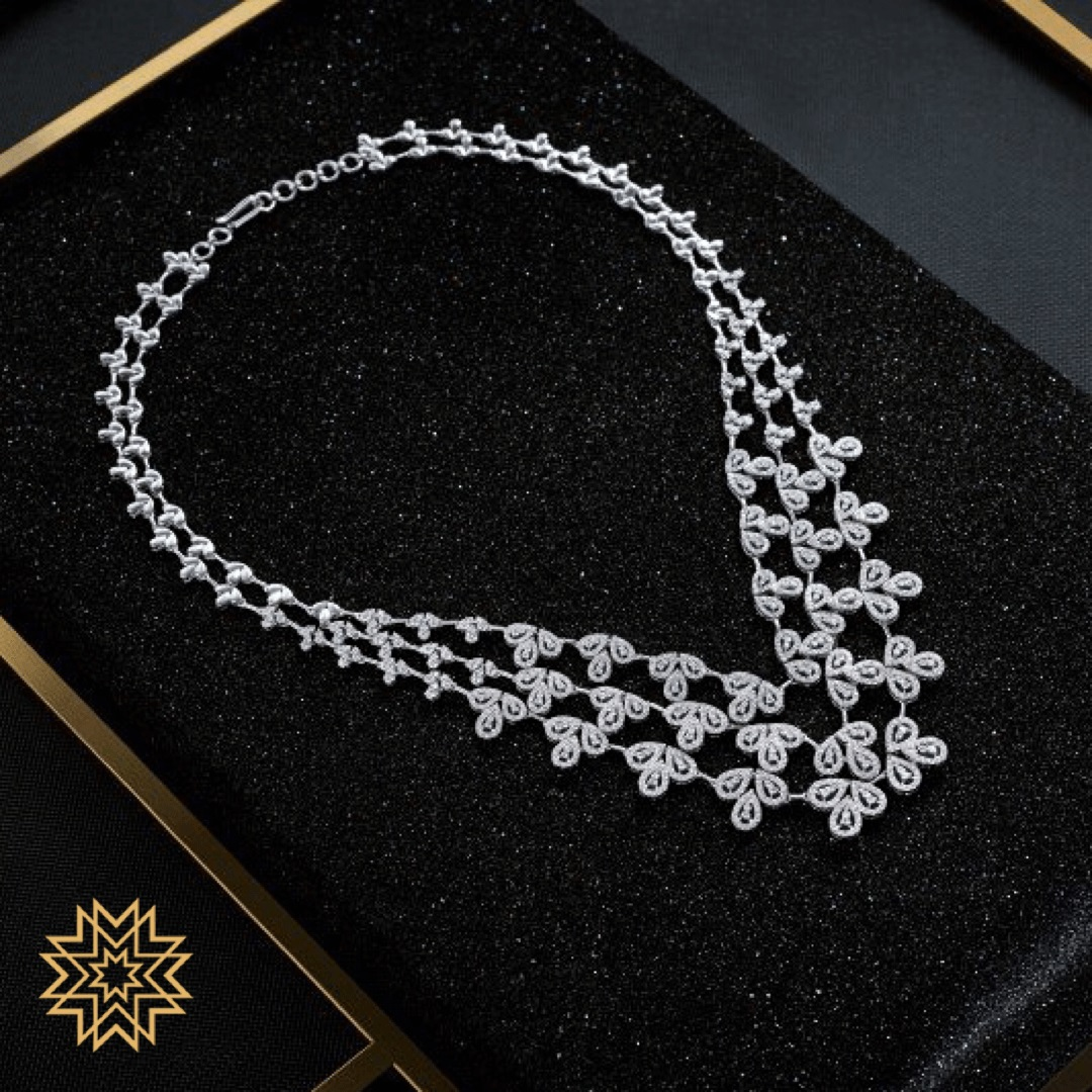 The red carpet ready bride. A delicate, three layered diamond necklace.