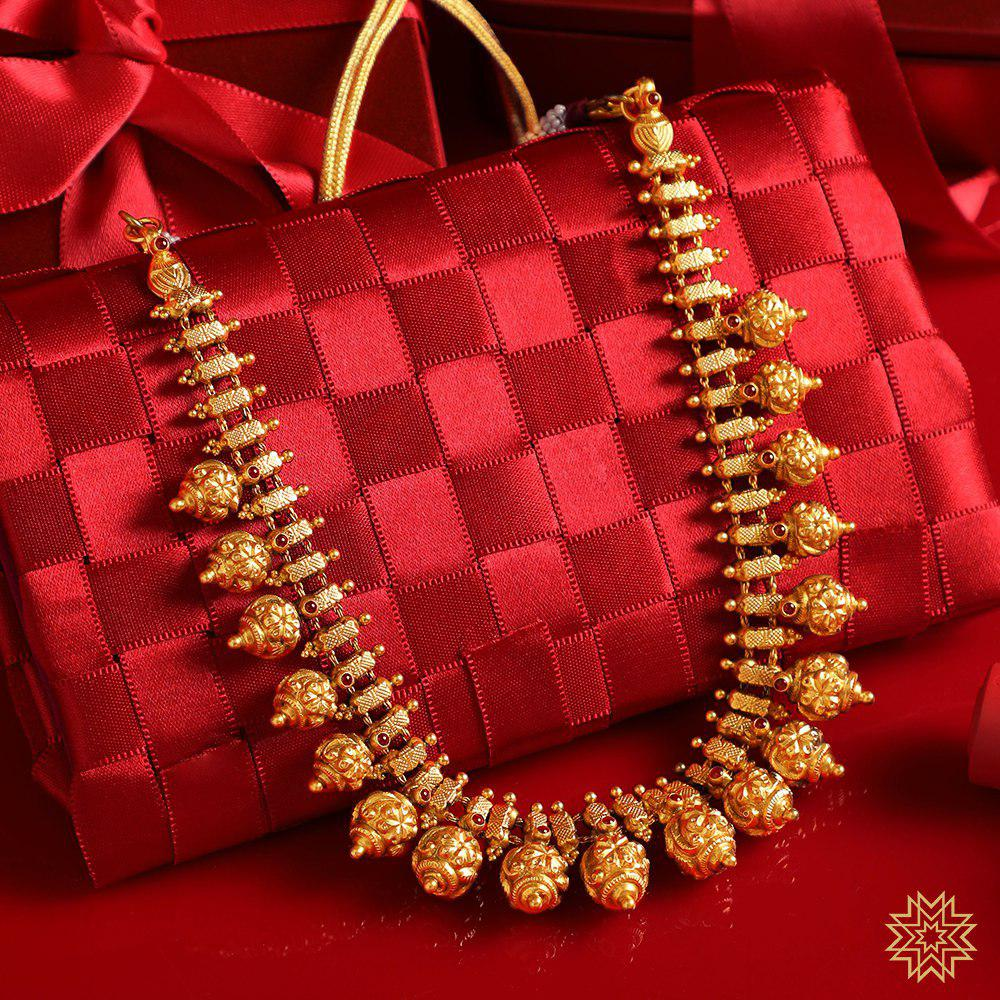 Antique Set by Manubhai Jewellers